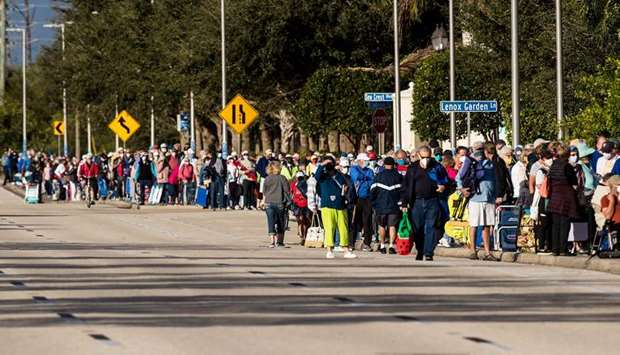Hundreds wait in line at Lakes Park Regional Library to receive the Covid-19 vaccine in Fort Myers,
