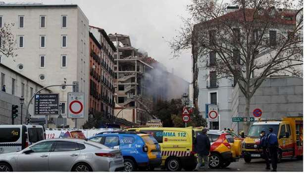 Fire fighters work after an explosion in Madrid downtown, Spain.