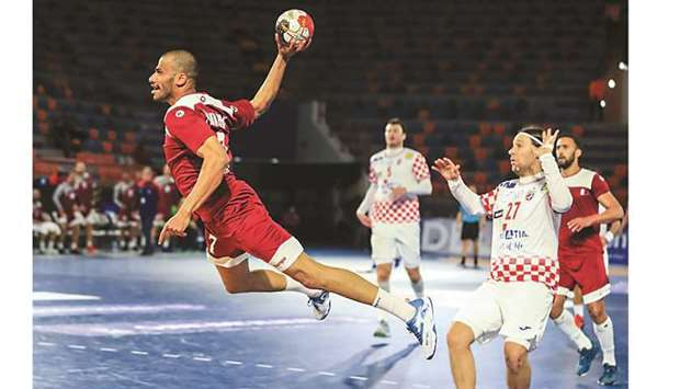 Action from the match between Qatar (in maroon) and Croatia (in white) during the preliminary rounds