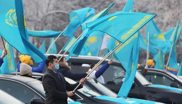 People wave national flags during a pre-election rally in Almaty, Kazakhstan