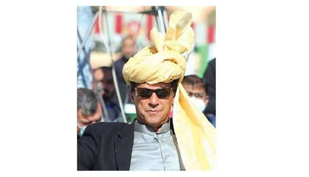 CONFIDENT: Prime Minister Imran Khan wearing a traditional headgear at the Kamyaab Jawan Programme (