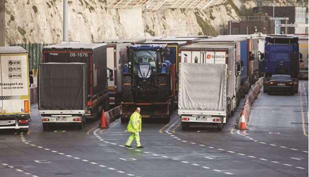 An employee directs haulage trucks as they enter the Port of Dover. In the euro area, supplier deliv