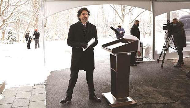 Prime Minister Justin Trudeau leaves a news conference at Rideau Cottage, as efforts continue to hel