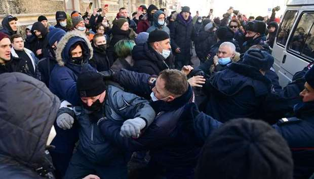 Demonstrators clash with police during a rally in support of jailed opposition leader Alexei Navalny