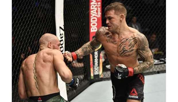 Dustin Poirier punches Conor McGregor of Ireland in a lightweight fight.
