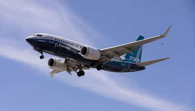 A Boeing 737 MAX airplane lands after a test flight at Boeing Field in Seattle, Washington, US on Ju