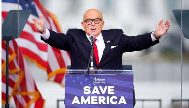 President Donald Trump's personal lawyer Rudy Giuliani gestures as he speaks as Trump supporters gat