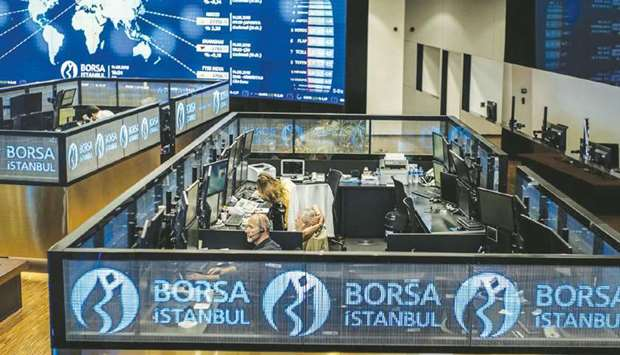 Employees work in booths at the Borsa Istanbul. UNCTAD's 2020 Global FDI report has mentioned QIA's
