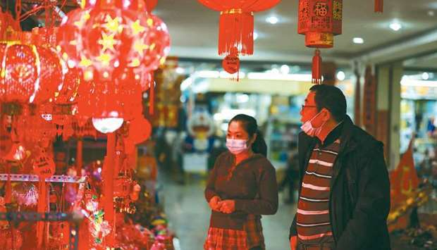 People look at festive decorations for the upcoming Lunar New Year at a market in Shenyang, in north