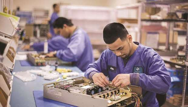 Employees assemble servers at the Z Microsystems manufacturing facility in San Diego, California. De