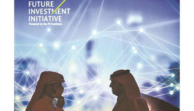 Delegates speak together as they attend the fourth edition of the Future Investment Initiative (FII)