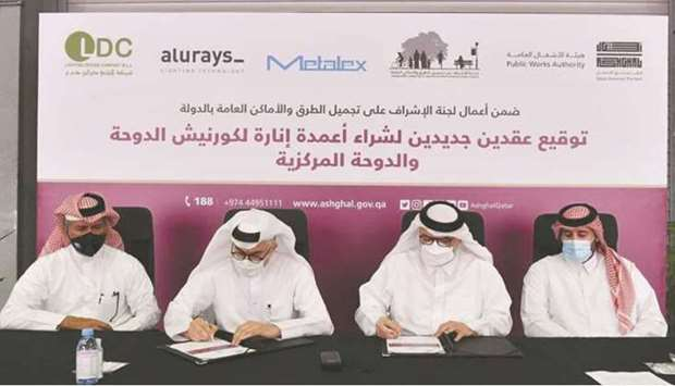 Ashghal president Dr Saad bin Ahmed al-Muhannadi signing the contracts with representatives of local