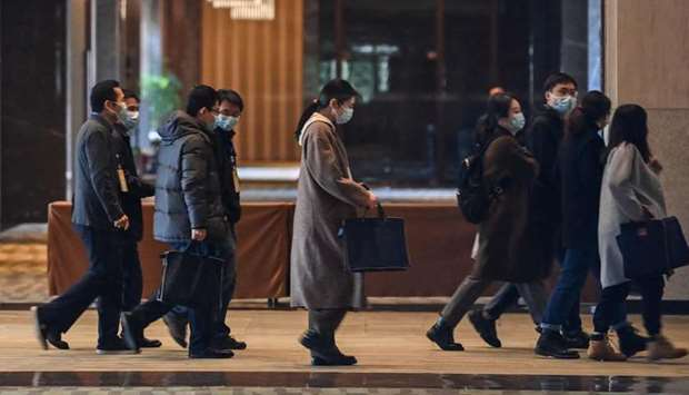 Chinese officials arrive for meetings with the World Health Organization (WHO) team investigating th