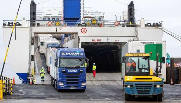 Freight lorries and HGVs (L) and unaccompanied freight (R) disembark from the Stena Line ferry 'Kerr