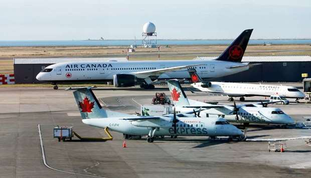Air Canada airplanes are pictured at Vancouver's international airport in Richmond, British Columbia
