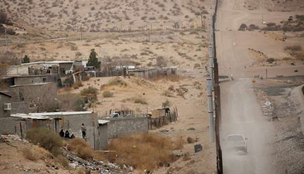 A general view shows a section of the border fence between Mexico and United States at Anapra neighb