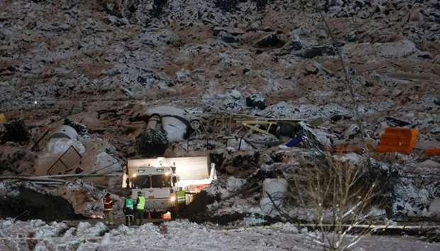 Rescue crews work at the site of a landslide in Ask in Gjerdrum,on January 2, following a landslide