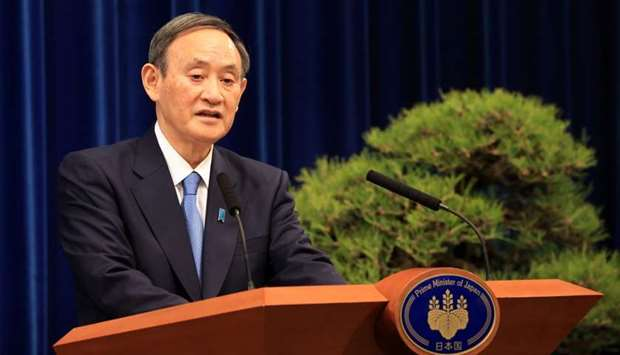 Japanese Prime Minister Yoshihide Suga holds a New Year's press conference at his official residence