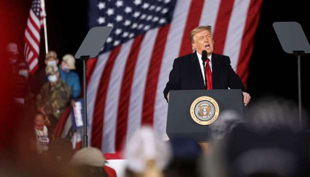 US President Donald Trump speaks during a rally in support of Republican incumbent senators Kelly Lo