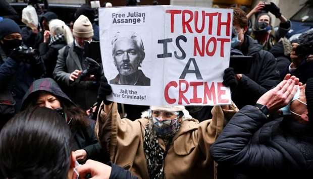People celebrate after a judge ruled that WikiLeaks founder Julian Assange should not be extradited