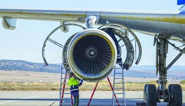 A mechanic works on a passenger aircraft engine at Teruel Airport in Teruel, Spain.