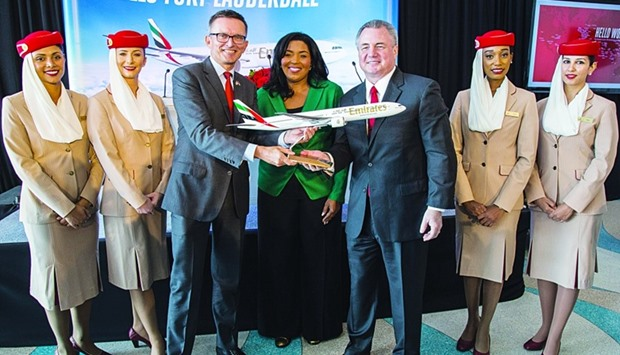 A ceremonial gift exchange between Barbara Sharief, Hubert Frach  and Mark Gale in Fort Lauderdale