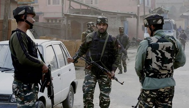 Army at the site of militant attack on their convoy in Kadlabal area of Pampore in south of Srinagar