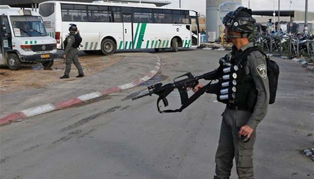 A member of the Israeli police stands guard at the checkpoint