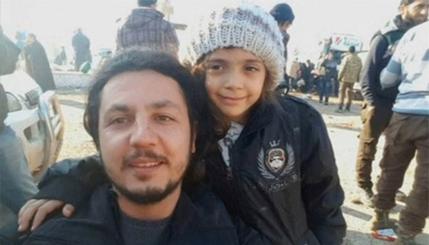 Syrian girl who tweeted from Aleppo, Bana Alabed, posing with IHH aid worker