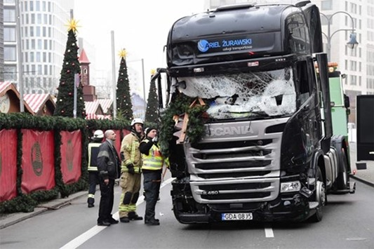 The truck that crashed into a Christmas market in Berlin is pictured on Tuesday