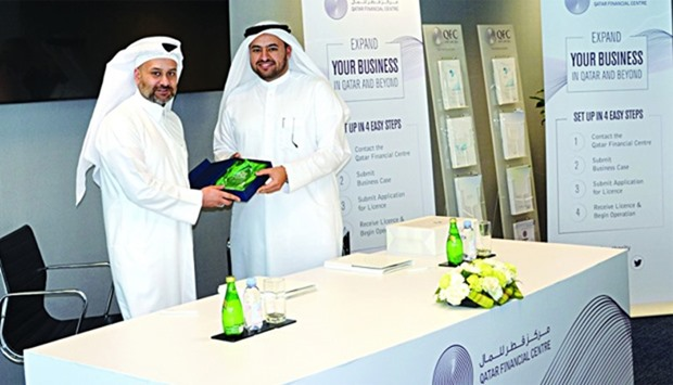 Al-Jaida (left) with al-Khulaifi during the agreement signing between Qatar Financial Centre Authori