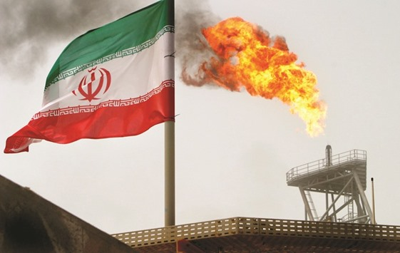A gas flare on an oil production platform in the Soroush oil fields is seen alongside an Iranian flag in the Gulf (file). Since sanctions on its economy were eased in January, the Gulf producer has doubled exports as prices rallied and won approval from Opec last month to pump even more while other members cut. The key to continued growth will be attracting foreign investment to the energy industry