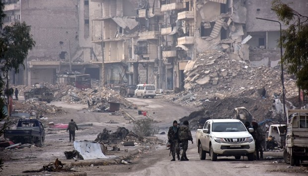Syrian regime forces stand near destruction in the former rebel-held Sukkari district