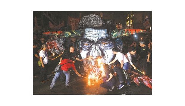 A recent photo shows activists and martial law victims burning an effigy of late dictator Ferdinand