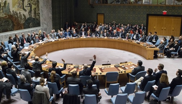 Members of the UN Security Council vote on a resolution to stop Israeli settlements.