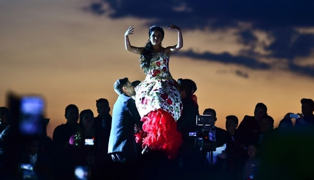 Rubi Ibarra (C)dances during her 15th birthday celebrations in Villa Guadalupe