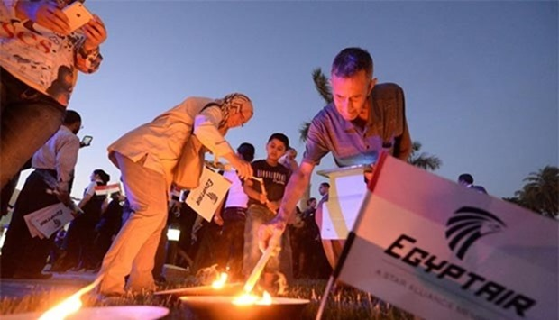 Egyptians light candles during a candlelight vigil for the 66 victims of the EgyptAir MS804