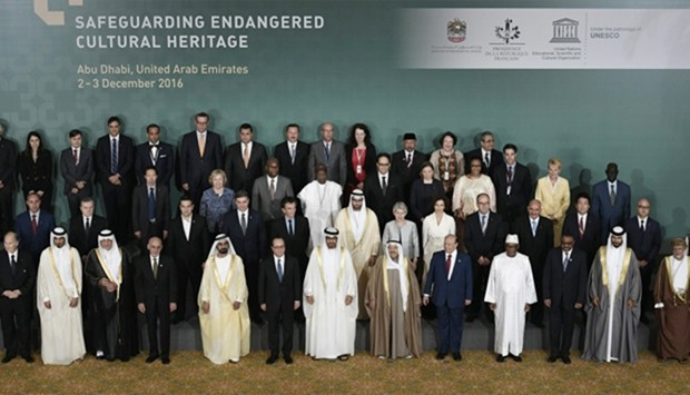 Officials pose for a group picture during the closing ceremony of an international conference on pro