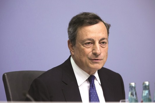 """ECB president Mario Draghi speaks during a news conference to announce the bank's interest rate decision at the ECB headquarters in Frankfurt yesterday. """"Markets, the financial intermediaries, proved much more resilient than people had expected,"""" Draghi said"""