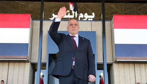 Prime Minister Haider al-Abadi greeting Iraqis in the capital Baghdad at the start of a military par