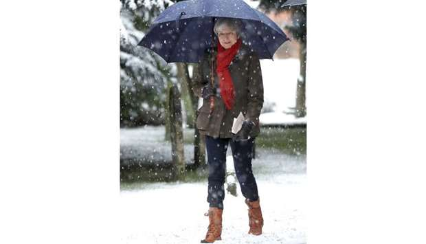 Prime Minister Theresa May leaves church, in Sonning, yesterday. The week ended with much of the Bri