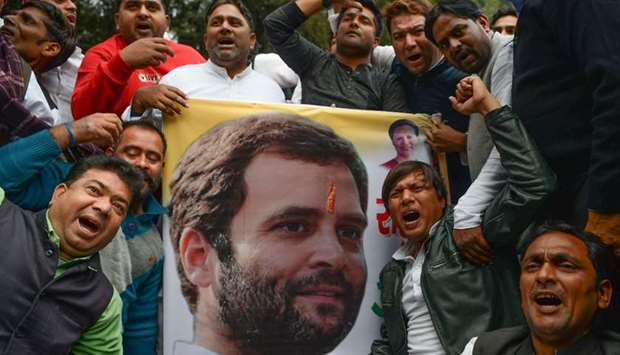 Indian supporters of the Congress Party shout slogans after the party named Rahul Gandhi president,