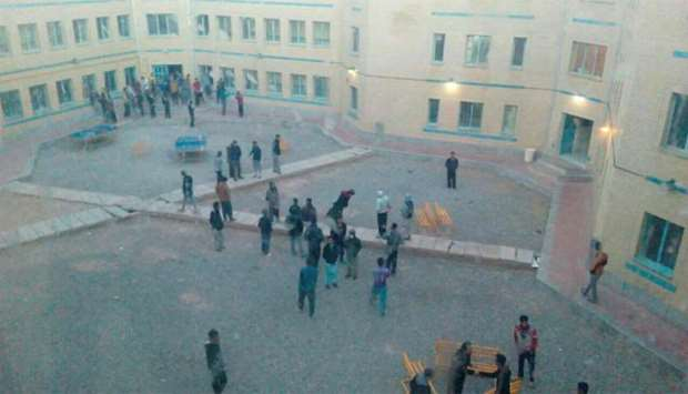 People are seen standing in the courtyard for safety after earthquake hit Kerman province