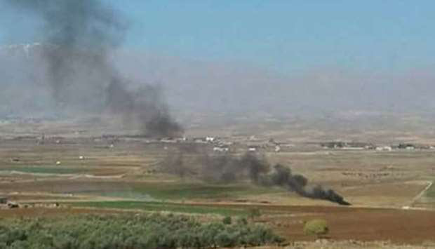 Smoke emanating from the crashed Syrian army helicopter.