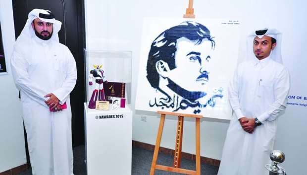 (From left) Faisal Mohamed al-Eissa and Abdulla Maqbool Khalfan with the 'Grendizer Official Qatar E