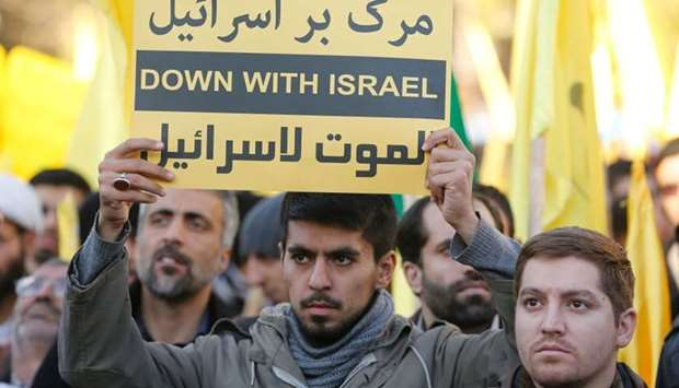 Iranian protesters hold anti-Israeli slogans during a demonstration in the capital Tehran