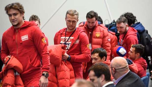 Russia's hockey players take their seats to attend a meeting of the Russian Olympic Committee in Mos