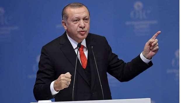 :Turkish President Tayyip Erdogan speaks during an extraordinary meeting of the Organisation of Isla
