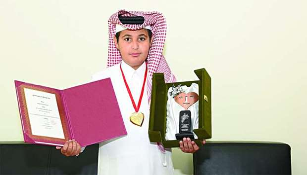 Abdulaziz al-Humaidi with his gold medal.