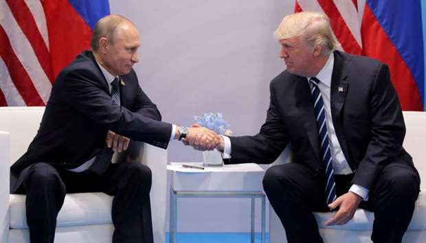 US President Donald Trump shakes hands with Russia's President Vladimir Putin during their bilateral